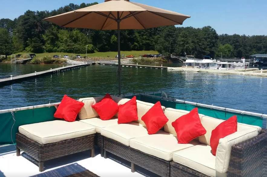 PRIVATE DOCK 3 level, 4 BR MUST SEE Flowery Branch, GA Body of water: Lake Lanier Rate: $118/night Apparently, the rare Lake Lanier houseboat with its own private dock, this three-floor beauty rocks a sweet rooftop lounge complete with water slides, diving board, and the kind of cool outdoor furniture usually reserved for trendy nightclubs.