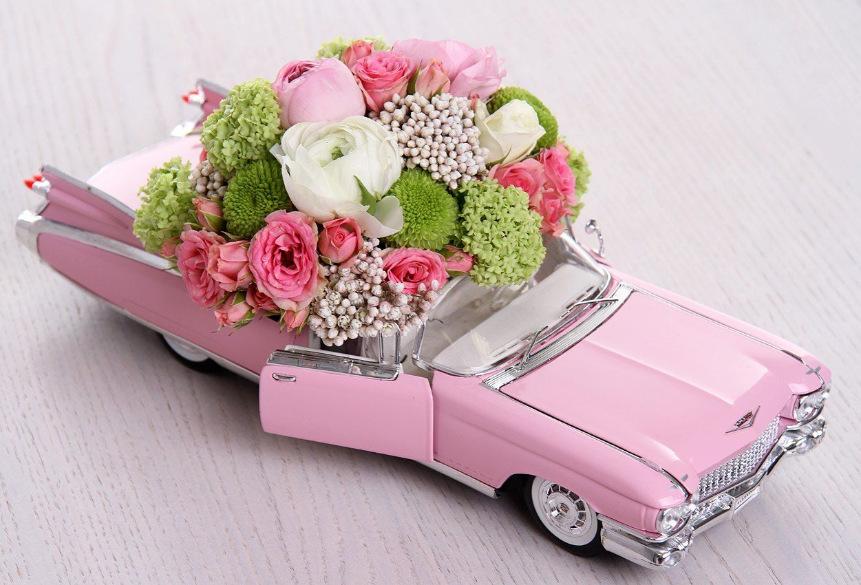 How fun to add a car, with flowers as a show piece. Shower, wedding ...
