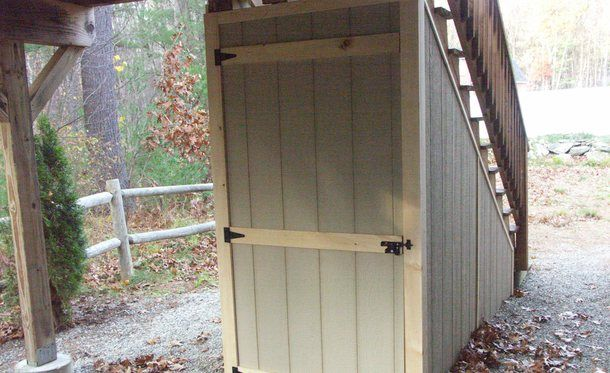 Great use of space a storage shed built under a deck for Garden shed on decking
