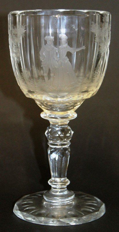 A MOSER GLASS GOBLET, the bowl engraved with classical figures Signed Moser.