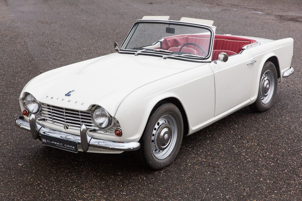 Mint condition 1964 Triumph TR4 in white with red interior