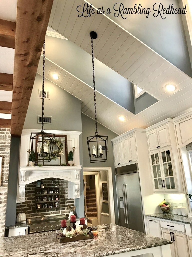 Cedar beams warm up white shiplap ceiling white cabinets glass fronts gray walls