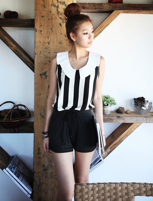 Beauty sports a vertical-striped shirt and shorts.