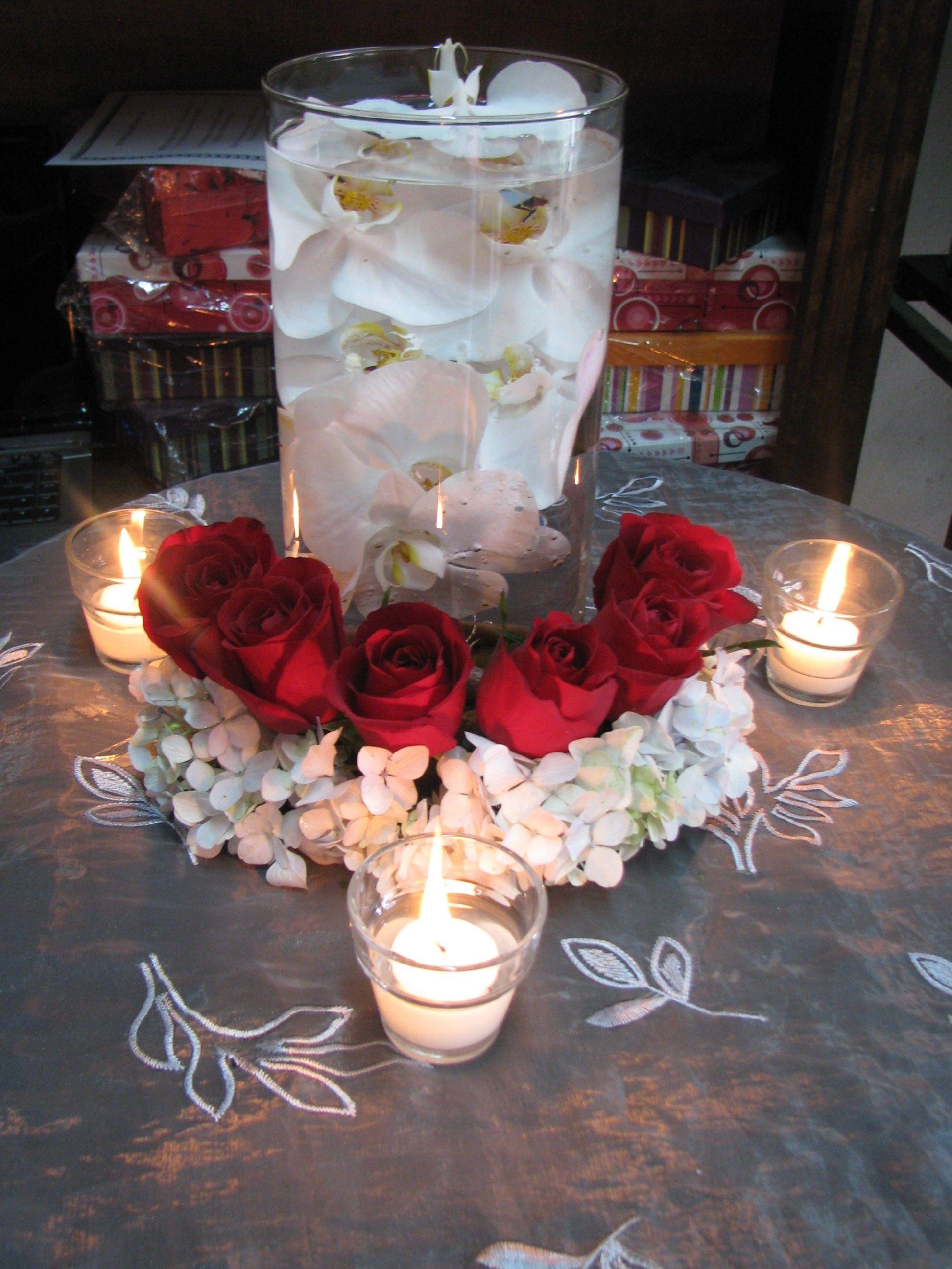 Centro de mesa con orquideas y velas flores pinterest - Centros con velas ...