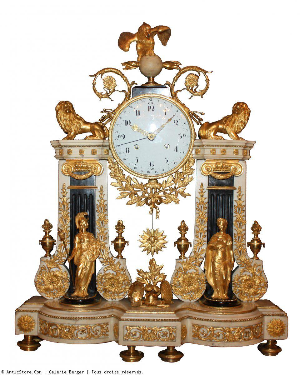 A Large Louis Xvi Portique Ormolu And White Marble Mantel Clock Symbolizing Strength And Justice Antika Saatler Saatler Antika