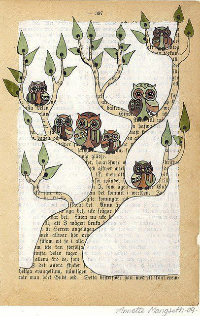 page from a book-- painted white, except for the tree trunk-- painted leaves and owls on top of that