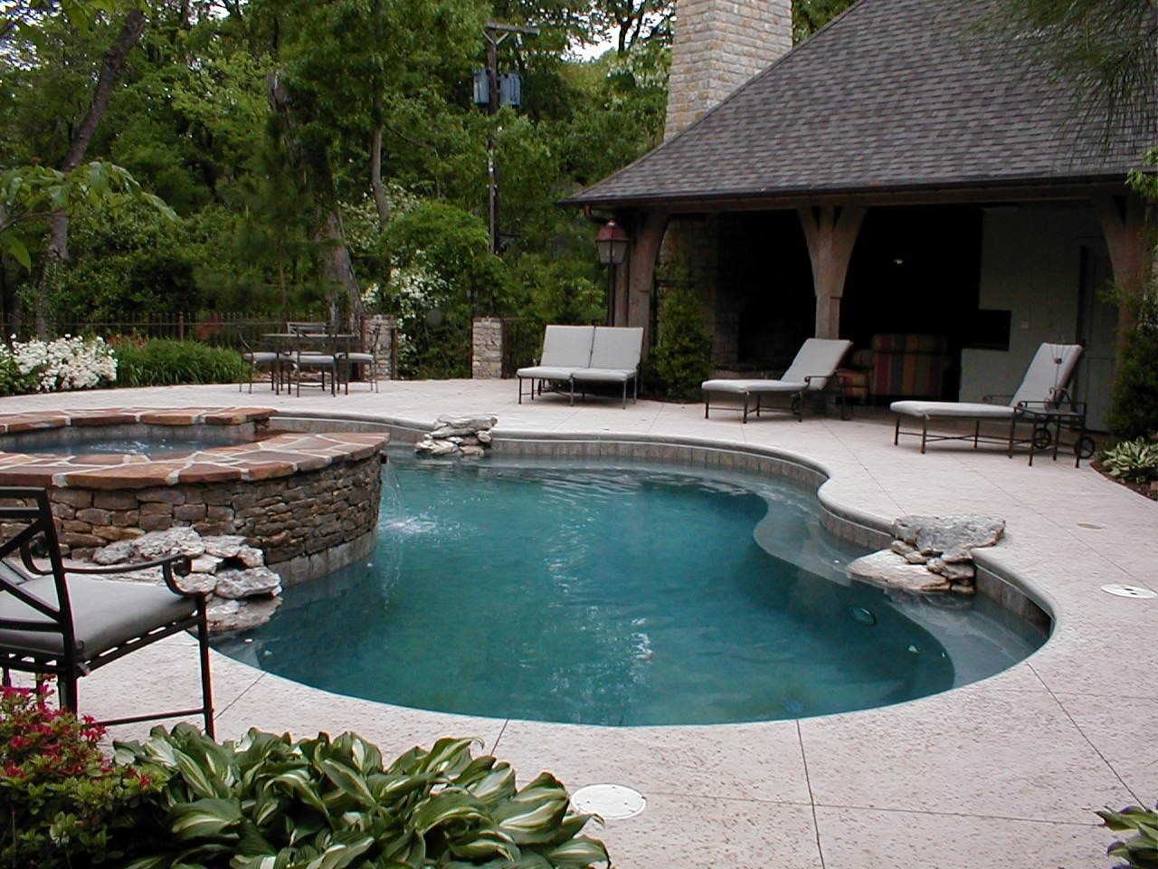 pool with hot tub and water feature