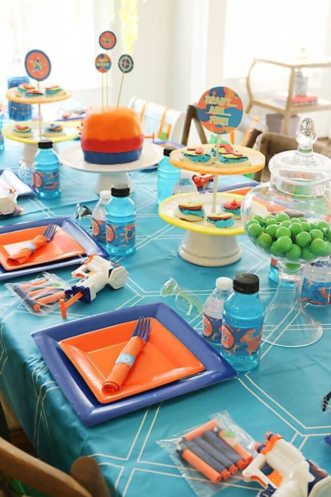 Every boy will be battling it out at a Nerf Gun Birthday Party! Fun party  and decor ideas for your next nerf gun birthday party.