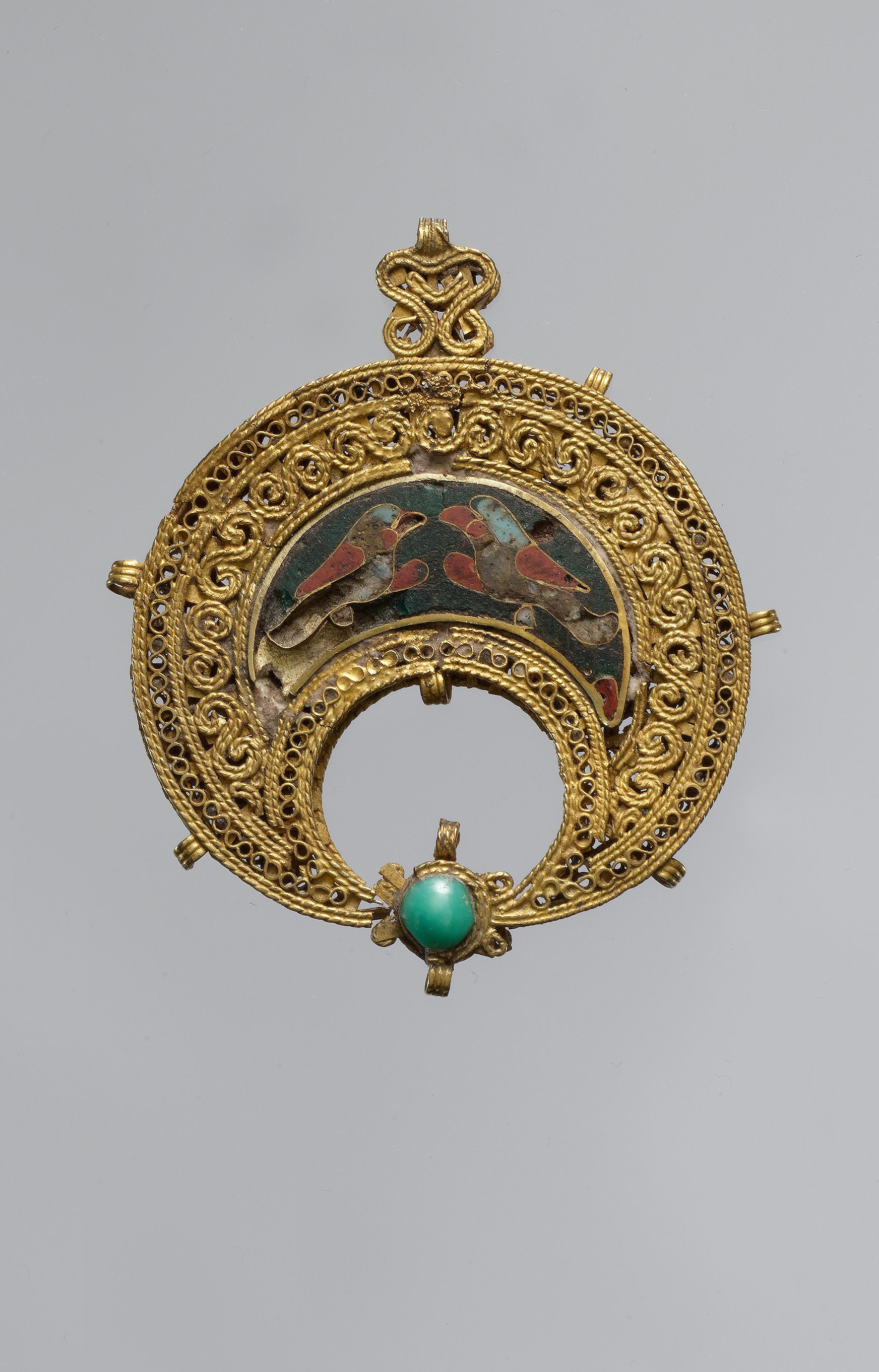 Crescent-Shaped Pendant with Confronted Birds 11th century EgyptCulture, IslamicMedium: Gold, cloisonné enamel, turquoise; filigree