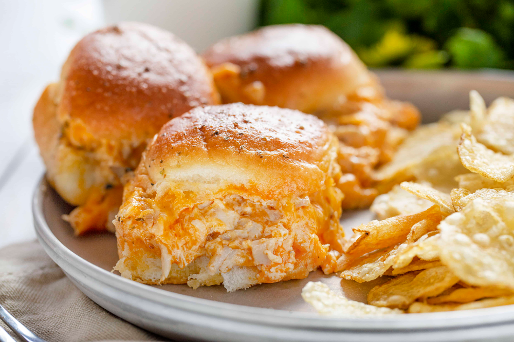 Buffalo Chicken Sliders are the perfect snacking sandwich! #buffalochicken #sliders #sliderrecipes #buffalochickensliders #appetizers #gameday #gamedayappetizers #aps #dinnerrolls #iambaker #buffalochickennachos Buffalo Chicken Sliders are the perfect snacking sandwich! #buffalochicken #sliders #sliderrecipes #buffalochickensliders #appetizers #gameday #gamedayappetizers #aps #dinnerrolls #iambaker #buffalochickennachos