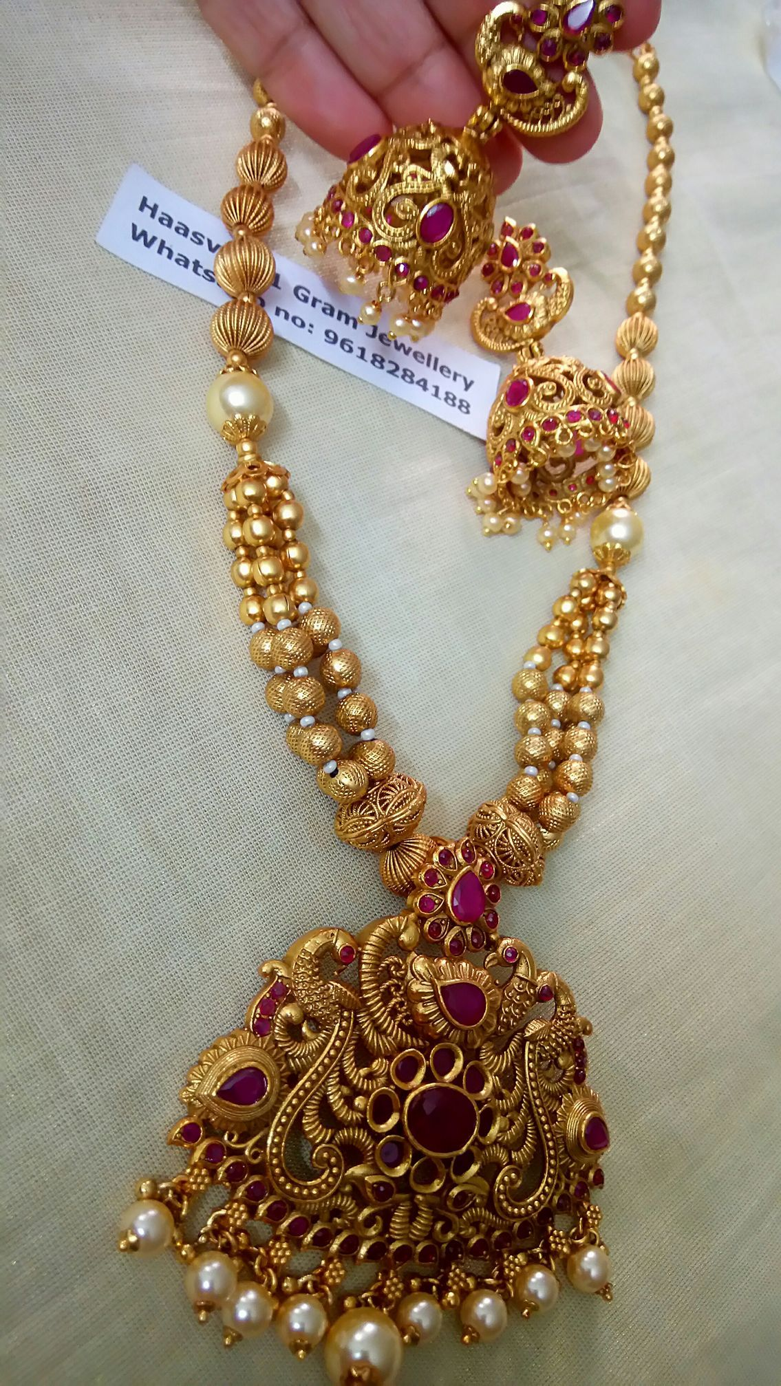eac45b1039 Beautiful long chain with one gram gold ball chain. Long haaram with  swimming swan design pendant. Long haaram with pearl hangings.