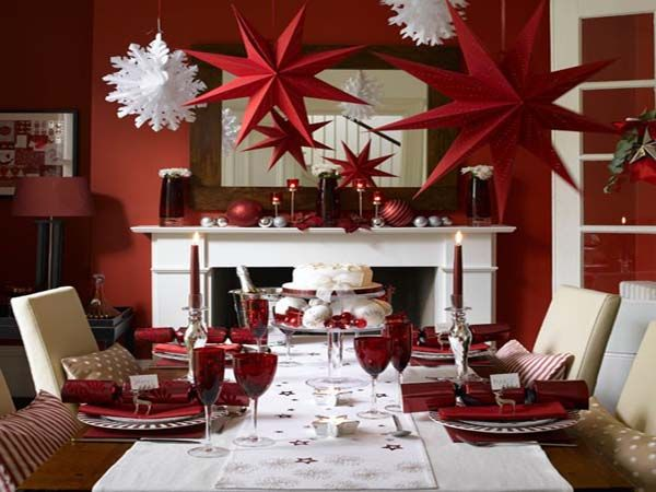 Decorations for christmas banquet love the red stars for Christmas dining room table arrangements