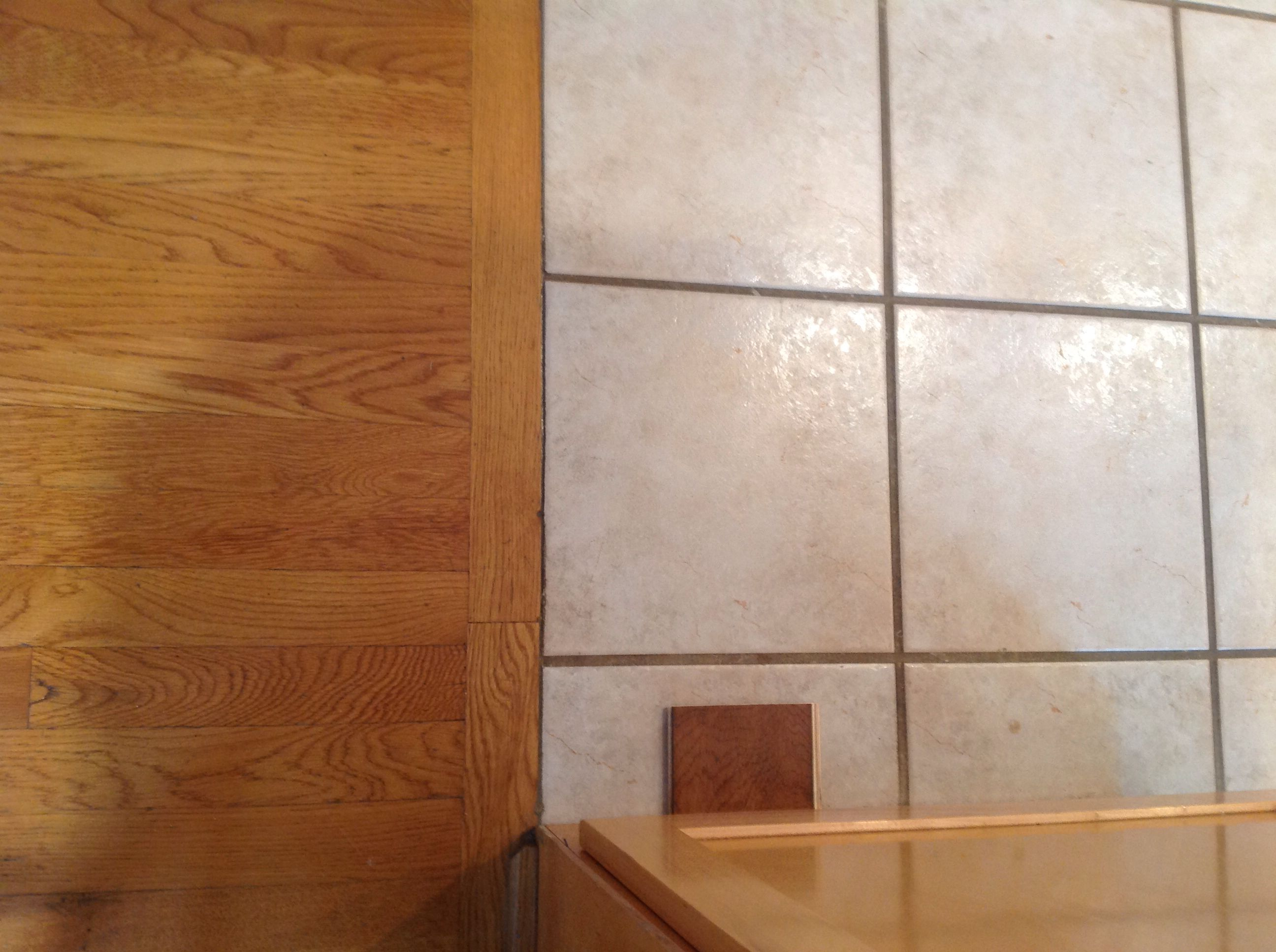 Replace tile and add oak hardwood flooring staining to a darker