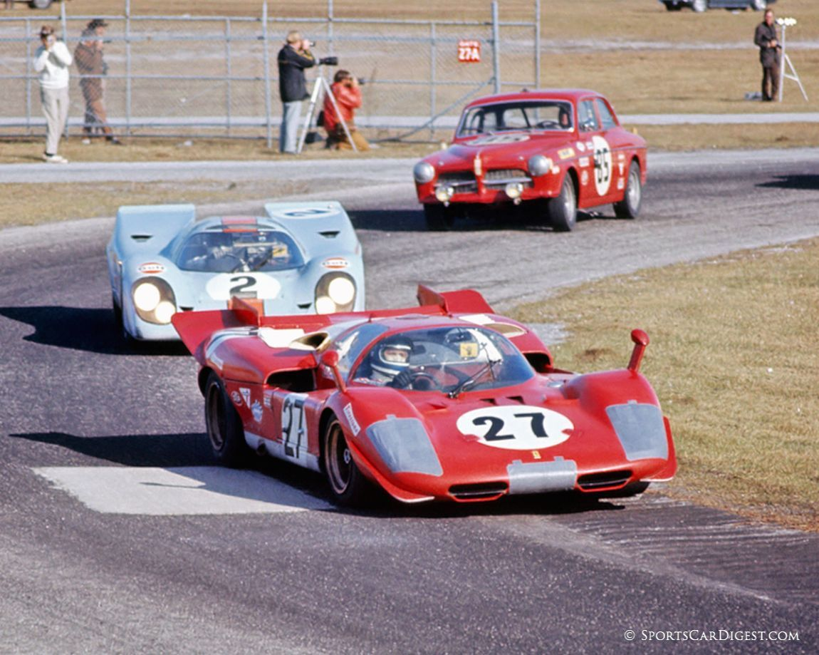 Going through turn six and onto the high banks are a Ferrari 512S, Porsche 917K and a Volvo 122 S. Only the Porsche would finish the race. (Fred Lewis photo)