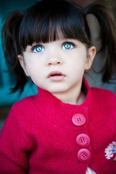 Girl With Black Hair And Sea Green Eyes
