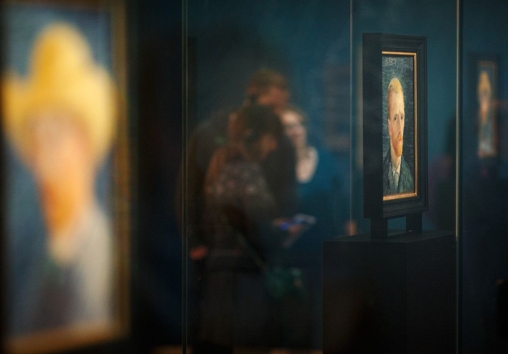 Visitors walk past self portraits of Dutch Post-Impressionist painter Vincent van Gogh on the ground floor of the Vincent van Gogh museum on November 25, 2014 in Amsterdam, Netherlands. The new presentation of the permanent collection of Vincent van Gogh (1853-1890) works focuses on the development of the artist and the myths surrounding Van Gogh's suicide, illness and ear are discussed in detail for the first time at the museum. On the ground floor of the museum, visitor's first walk ...