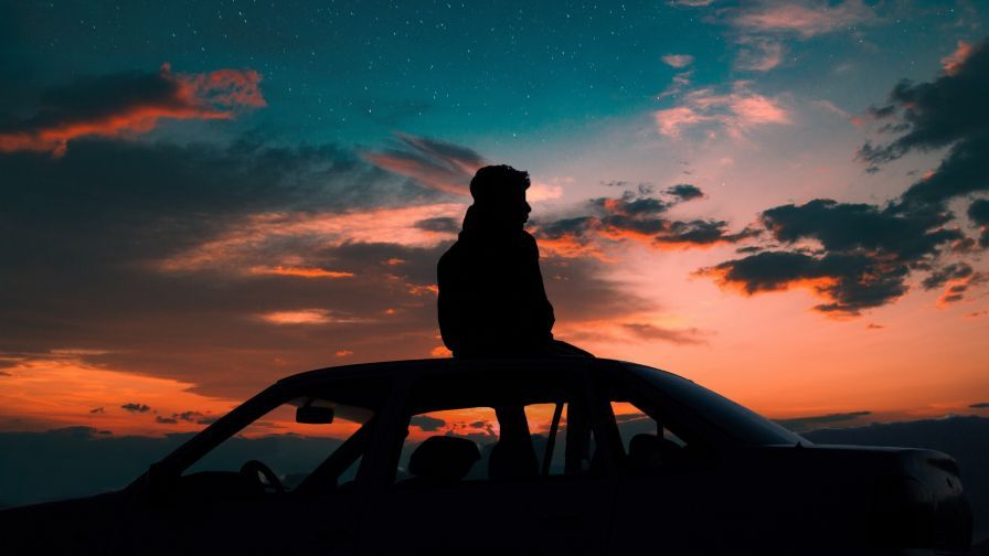 Man Standing At The Roof Of Car Hd Wallpaper Wallpapers Net