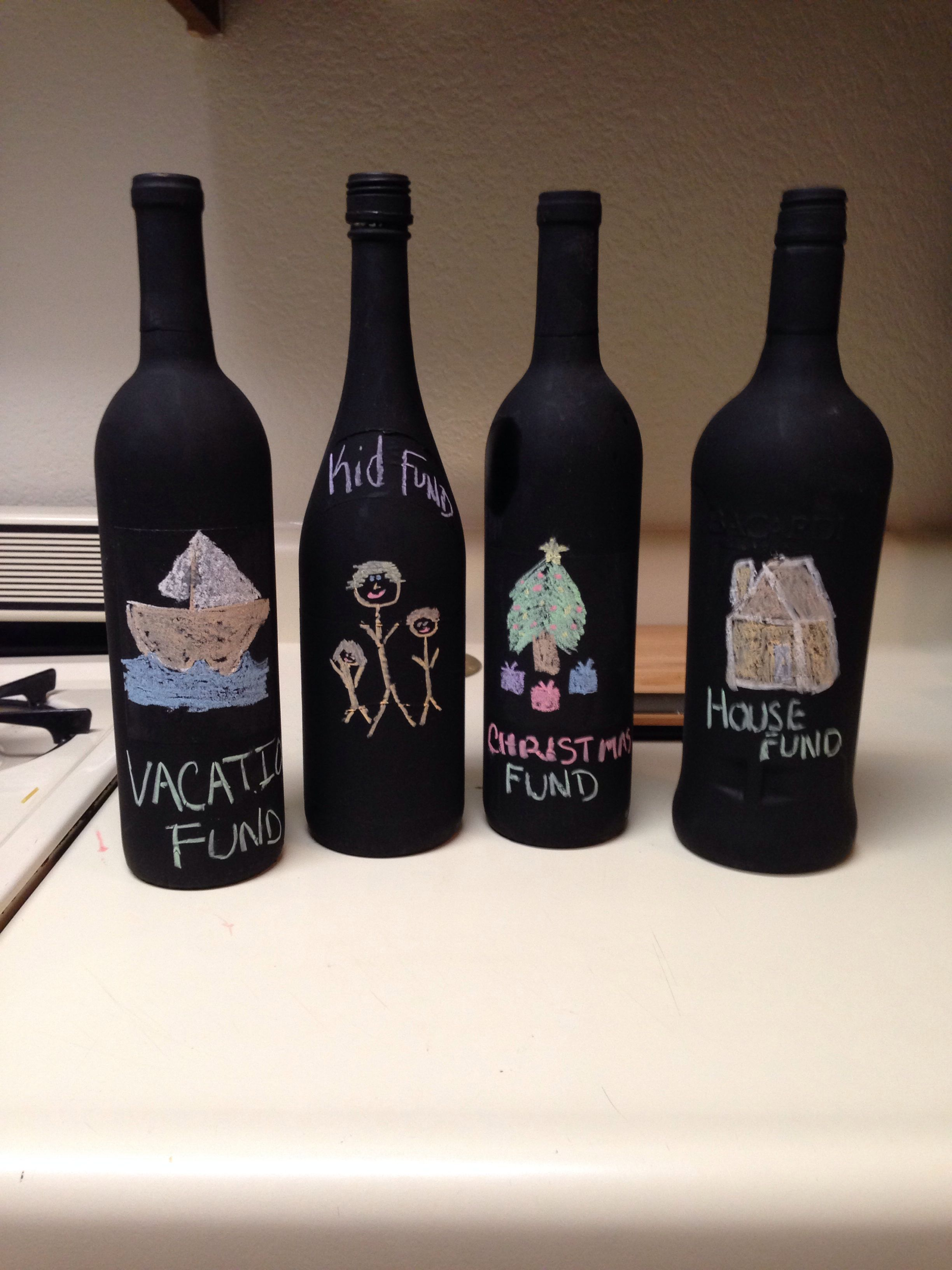 My husband and I needed a new way to save money. We used some old wine bottles and painted them with chalkboard paint. After the bottles dried, we decorated them using chalk to write what we were going to save up for. On the back we have how much $ we put in the bottles. Once we hit out goal or the bottle is stuffed with cash, we'll break open the bottles. It's fun and frugal!