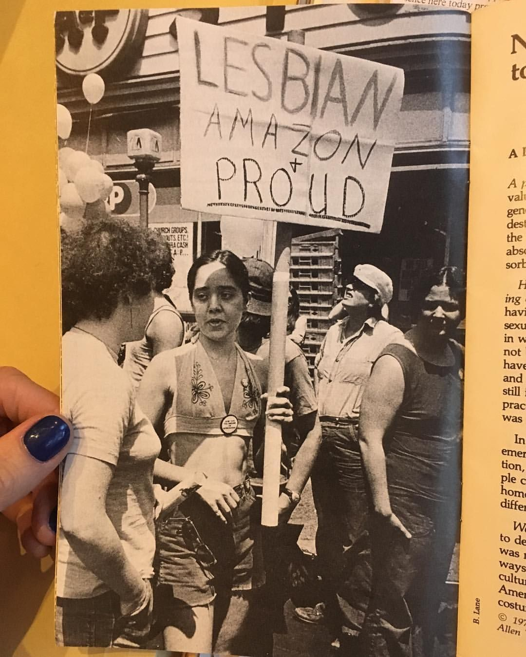 """""""Lesbian, Amazon, and Proud"""" - This picture is the inside cover of the March on Washington for Lesbian and Gay Rights """"souvenir program,"""" 1979.  Photo credit: Bettye Lane"""
