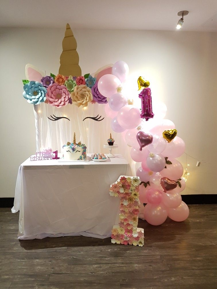 Unicorn setup for a sweet first birthday party First
