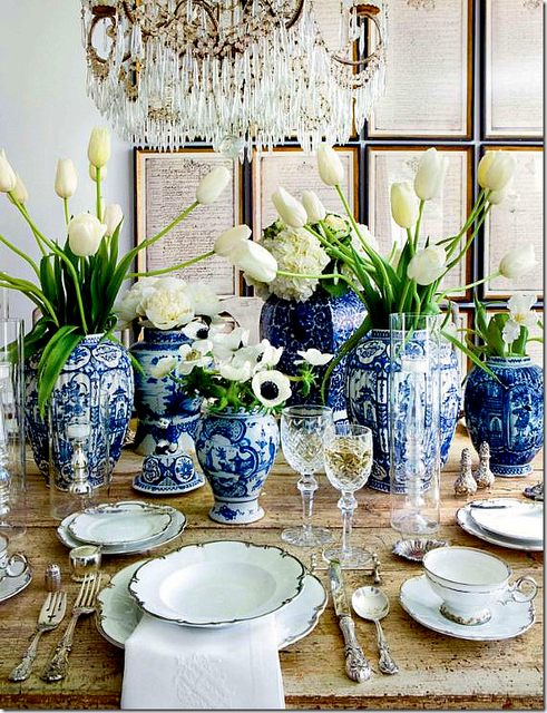 tulips, gold scalloped plates, vintage blue vases... perfect table setting