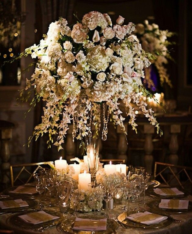 Elegant wedding centerpieces with candles roses