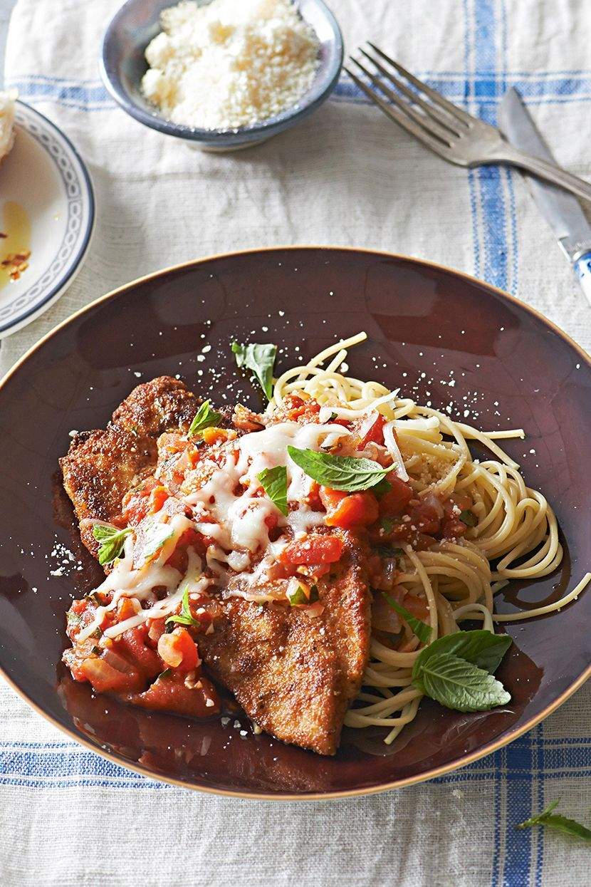 Featuring a Parmesan- and oregano-infused breading and a garlicky homemade tomato sauce, this is one of our favorite chicken breast recipes when we're craving comfort. Pile it all over noodles for a meal that will earn five stars. #dinnerideas #chickenrecipes #bestchickenrecipes #easydinnerideas #bhg