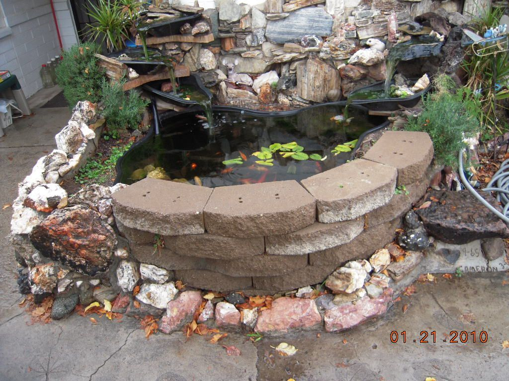Above ground pond ideas above ground pond designs jard n for Above ground koi fish pond