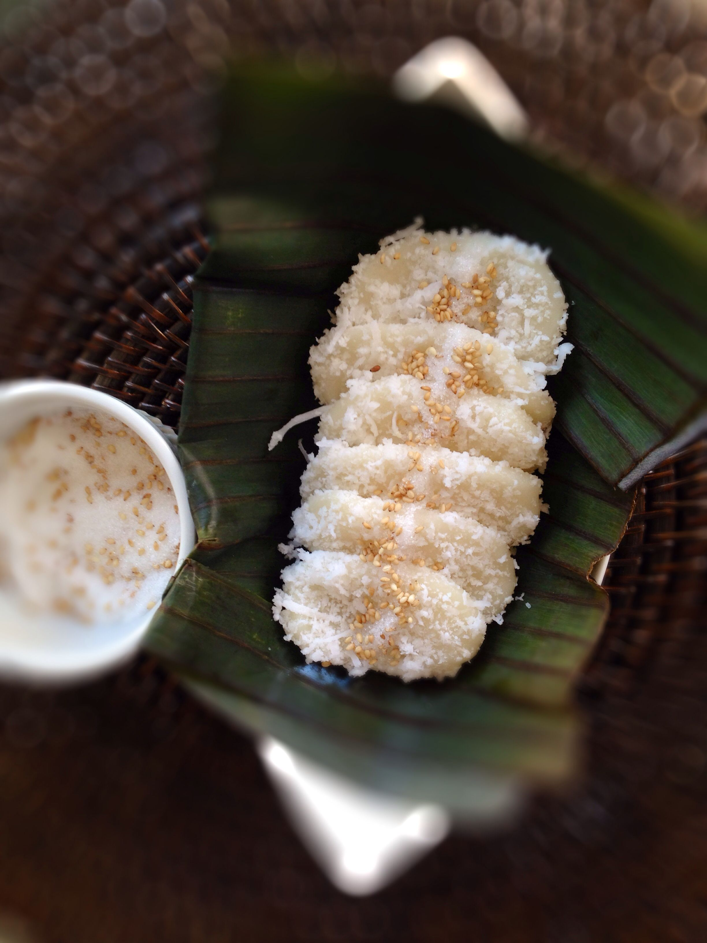 Palitaw with freshly grated coconut, sugar and sesame seeds (Filipino sticky rice dumplings)