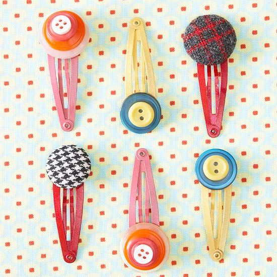 Button up your knit hat or side swept bangs with these cute recycled button hair clips.
