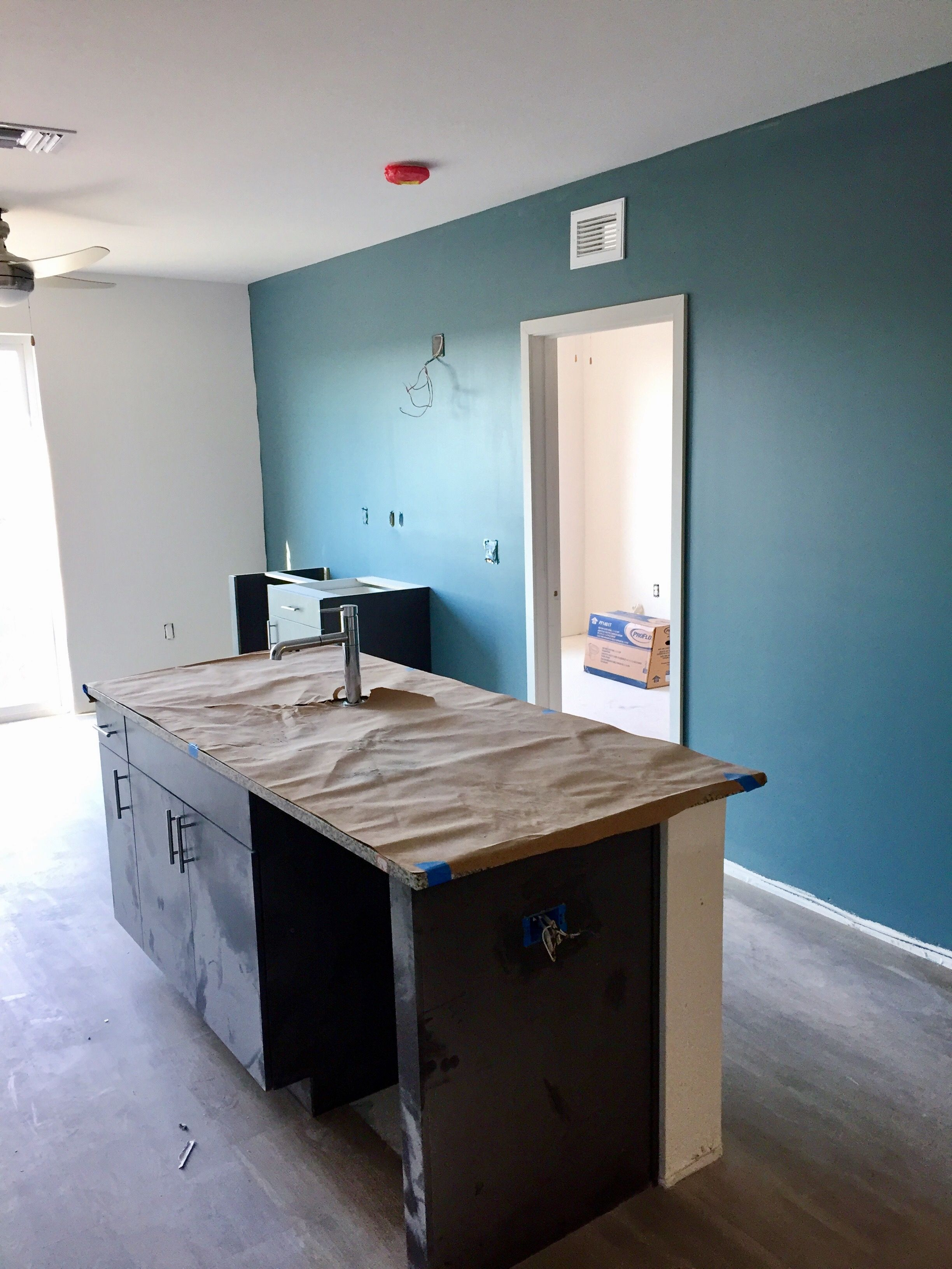 Our accent wall looks great with the dark wood cabinets in the ...