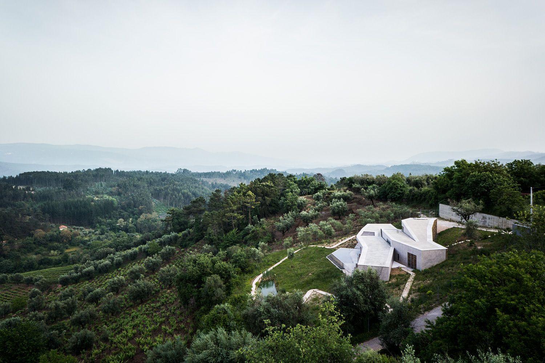Camarim have designed a magnificent hillside home overlooking Portugal's Serra da Estrela, the highest mountain range in the country.