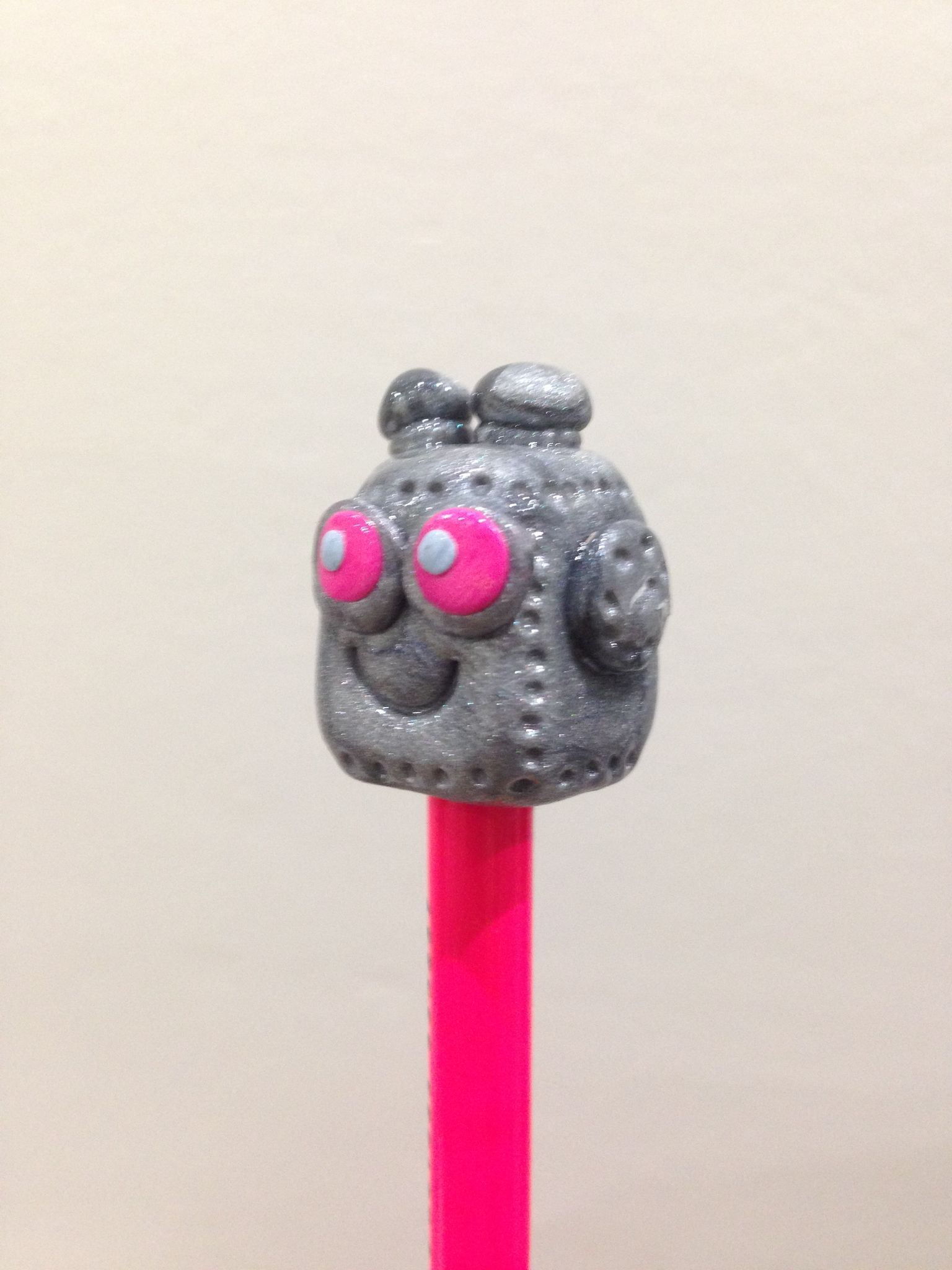 Pencil topper in clay. Little robot