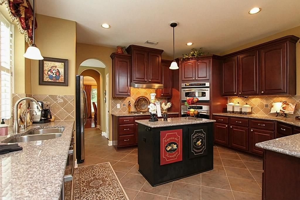 red oak kitchen cabinets with GE Slate appliances - Google ...