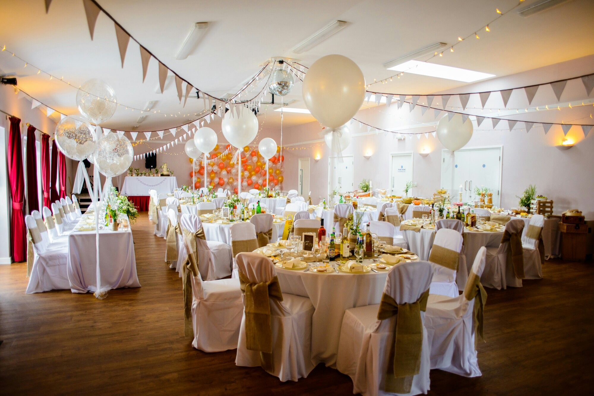Wedding decoration ideas balloons  Simple village hall transformed in DIY wedding Bunting balloons