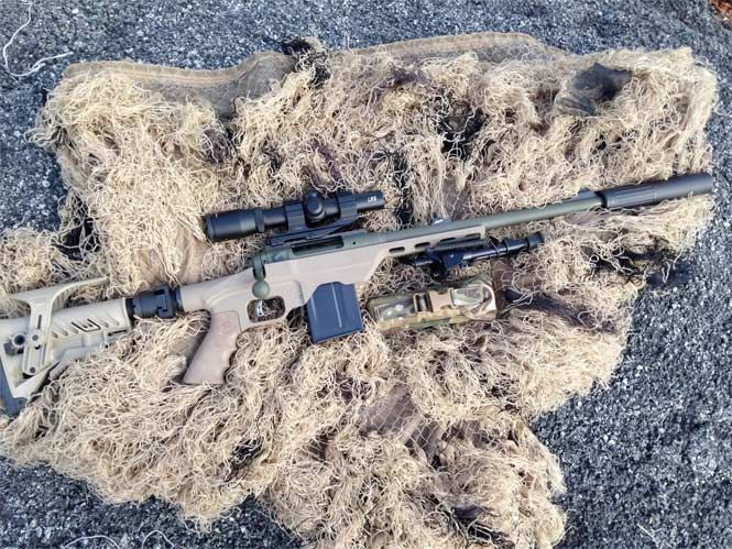 "Fort Daniel Built Rifle   Specs:  Savage 11 Hog Hunter Barrel shortened to 16.5"" and threaded 5/8X24 OD Green Cerakote AAC Blackout suppressor adapter MDT LSS Chassis in FDE Cerakote"