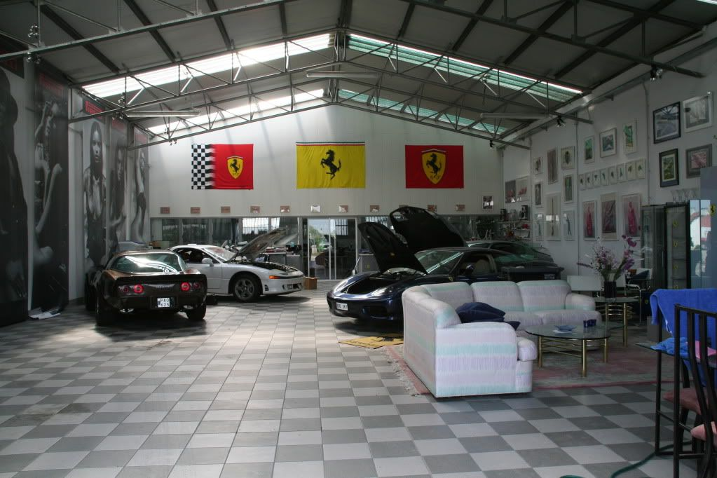 Nice garage garages pinterest dream garage men for Luxury garage interiors
