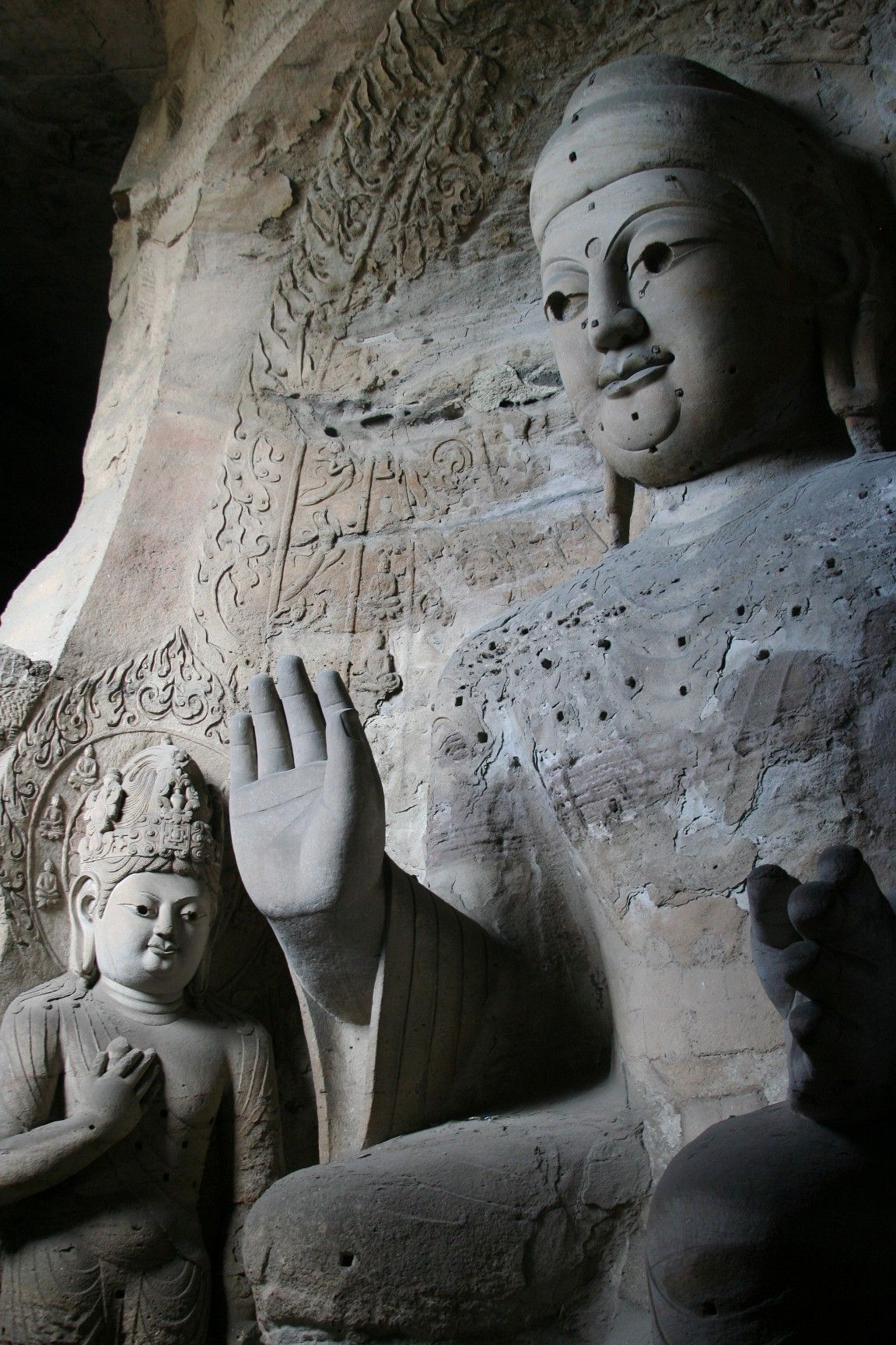 Maitreya (left) in the Yungang Grottoes, Cave 3 (471 – 494 CE). The wooden statue (right) outside the cave was added in the Qing dynasty (1644 – 1912).