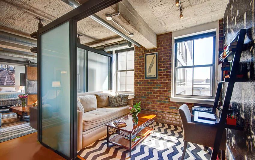 Loft Apartment With Living Room Bedroom Combo Behind Frosted Gl Sliding Doors And Wood Barn