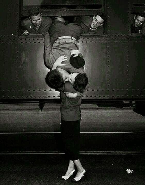 A goodbye kiss in the 1950's between a soldier & his love