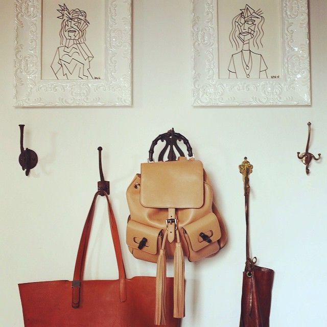 Faux foyer: Post vintage coat hooks by vintage art pieces.
