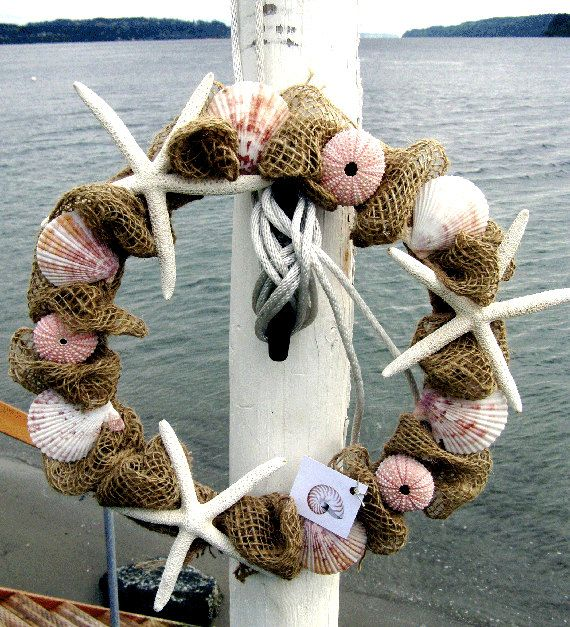 BEACH DECOR BURLAP wreath, nautical wreath, pink sea urchins, striped shells, starfish. $39.50, via Etsy.