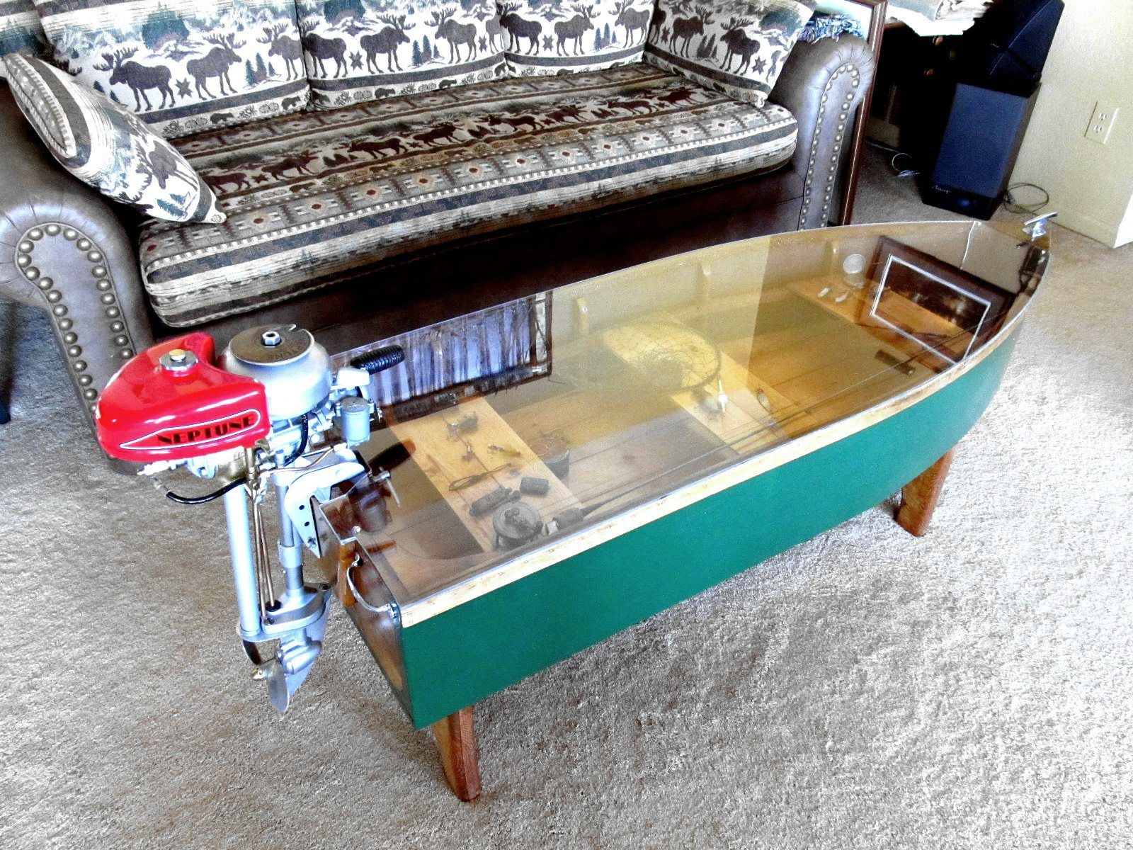 love this adorable boat coffee table with fishing glass floats
