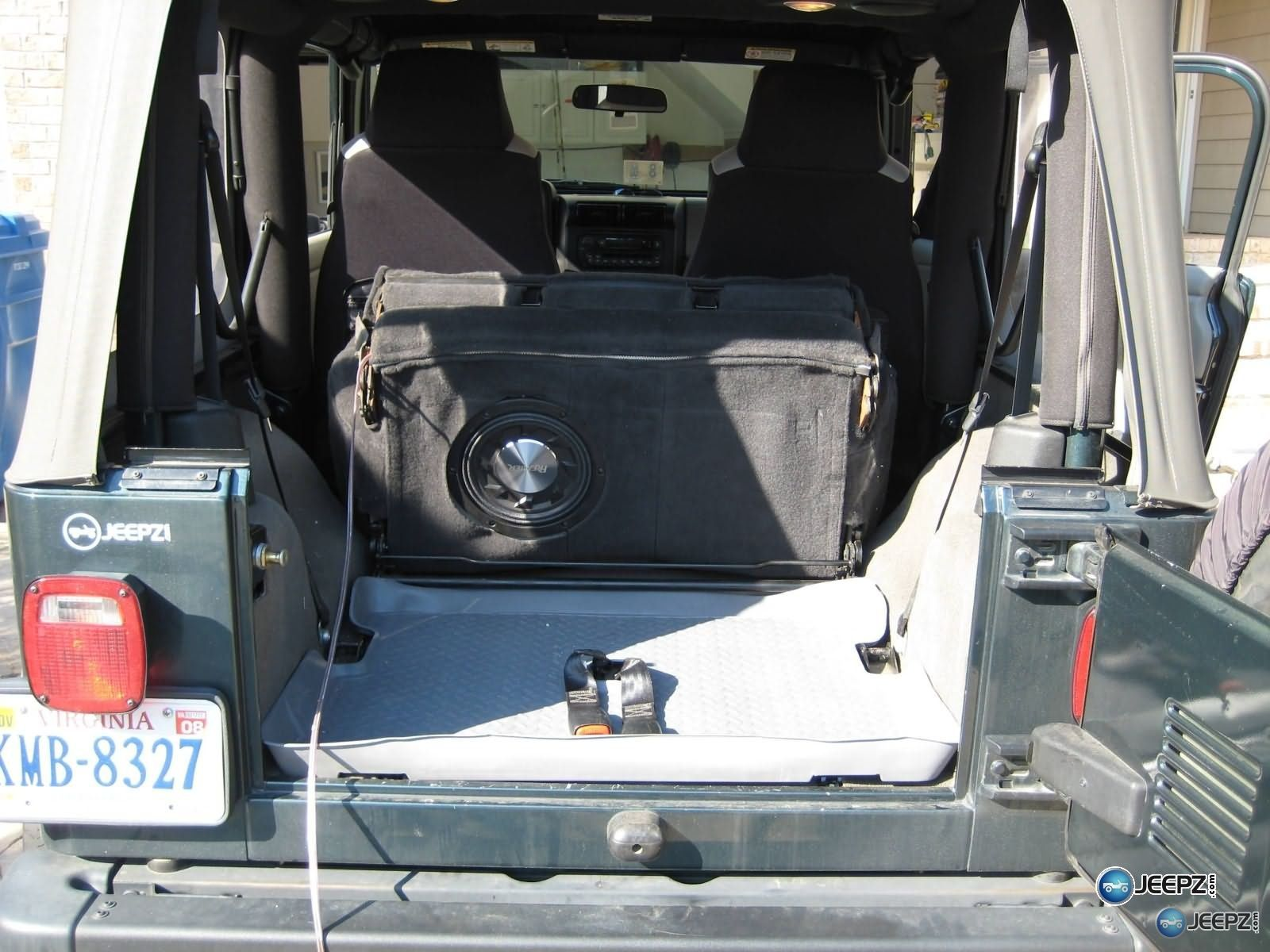Subwoofer inside of a Jeep Wrangler rear seat Jeep