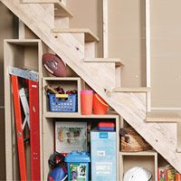 Make The Most Of The Space Under Your Stairs With These Built In