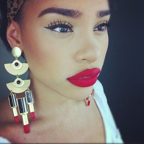 Amazing earrings and lipstick color.