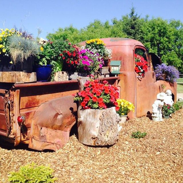 Old truck turned into beautiful flower bed Lawn art