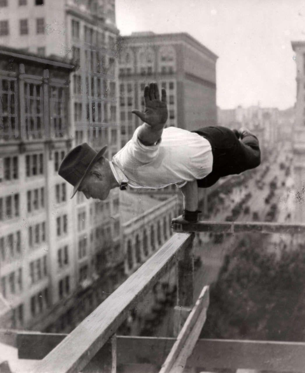 Acrobatics. Large Extent Man Horizontally Arm Scaffolding. York
