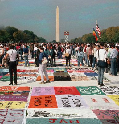 People Looking at the AIDS Quilt on the national Mall. The quilt will be displayed at two events in Washington in 2012.