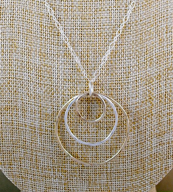 Triple Ring Pendant Necklace by Cameron Kruse Designs on Scoutmob